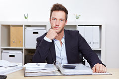 Portrait of business man at desk Royalty Free Stock Images