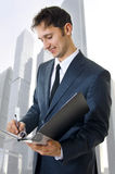 Portrait of a business man filling a form Royalty Free Stock Photo