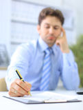 Portrait of a business man filling a form, Royalty Free Stock Image
