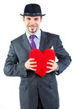 Portrait of a business man with hat and red heart Stock Photos