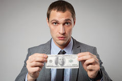 Portrait of a business man holding money Royalty Free Stock Photo