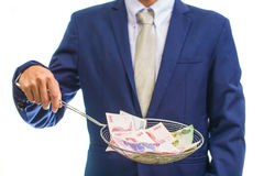 Portrait of a business man holding money Royalty Free Stock Photos