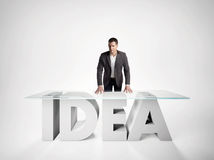 Portrait of a business man leaning on IDEA table Stock Images