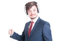 Portrait of business man listening to headphones and smiling Stock Photos