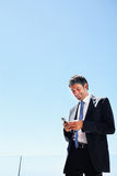 Portrait of a business man messaging on a mobile Royalty Free Stock Photography
