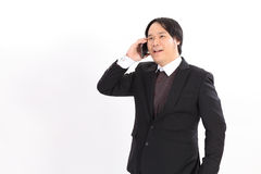 Portrait of a business man with phone  on white backgrou Stock Images