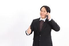 Portrait of a business man with phone  on white backgrou Royalty Free Stock Photo