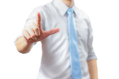Portrait of business man pointing with finger Stock Photo