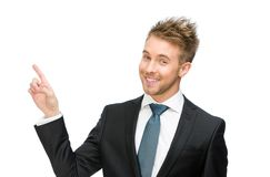 Portrait of business man pointing finger gesture Stock Images