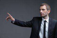 Portrait of business man pointing finger gestures Royalty Free Stock Photo