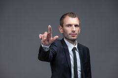 Portrait of business man pointing hand gestures Royalty Free Stock Photography