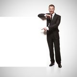Portrait of business man showing blank signboard Royalty Free Stock Images