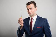 Portrait of business man showing one screwdriver stock image