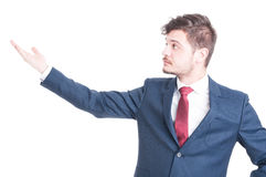 Portrait of business man showing something with his hand Royalty Free Stock Photos