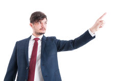 Portrait of business man showing something with index finger Royalty Free Stock Images