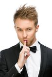 Portrait of business man silence gesturing Stock Photo