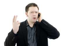 Portrait of business man talking on mobile phone. Royalty Free Stock Photography