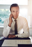Portrait of business man talking on the phone Royalty Free Stock Photography
