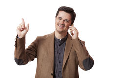 Portrait of business man using cellphone on white background.  royalty free stock image