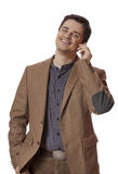 Portrait of business man using cellphone on white background.  stock photos