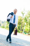 Portrait of business man walking Stock Photo