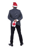 Portrait of a business man wearing a Santa Claus hat with holdin Royalty Free Stock Photo