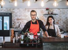 Portrait business owner couple wear apron. royalty free stock photo