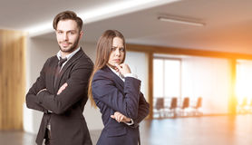 Portrait of business partners in office. Portrait of two business people standing in a modern office. Concept of partnership. 3d rendering. Mock up Stock Images