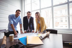 Portrait of business people with blueprint Stock Image