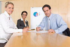 Portrait of business people discussing new strateg Royalty Free Stock Images