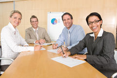 Portrait of business people discussing new strateg Stock Photo