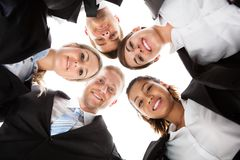 Portrait Of Business People Forming Huddle Stock Photo