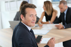 Portrait of business people in meeting Stock Images