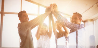 Portrait of business people raising hands seen through glass royalty free stock photos