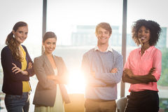 Portrait of business people standing with arms crossed Stock Photos