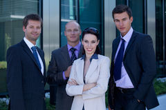 Portrait of business people standing side by side in suit Royalty Free Stock Photos