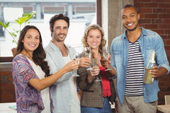 Portrait of business people toasting with champagne in office Royalty Free Stock Photo