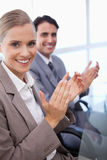 Portrait of a business team applauding. In a meeting room Royalty Free Stock Image