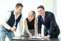 Portrait of business team in discussion. Royalty Free Stock Photos