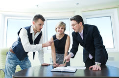 Portrait of business team in discussion. Royalty Free Stock Image
