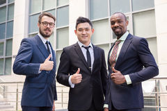 Portrait of business team holding their thumbs up Stock Image