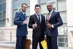 Portrait of business team holding their thumbs up Royalty Free Stock Photos