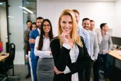 Portrait of business team posing in office stock photos