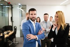 Portrait of business team posing in office stock photography