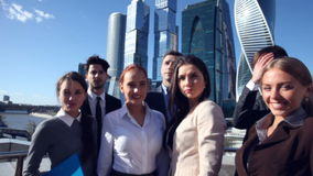 Portrait of business team. Standing at modern skycrapers background outdoors