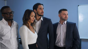 Portrait of business team standing in office Stock Image