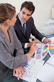 Portrait of a business team studying statistics in a meeting roo Royalty Free Stock Images