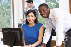 Portrait Of Business Team Working In Office Stock Photo
