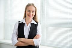 Portrait of a business woman. Portrait of a business woman against a window Royalty Free Stock Photo