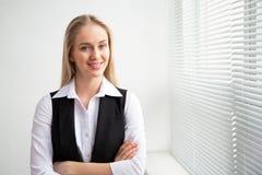 Portrait of a business woman. Portrait of a business woman against a window Stock Images
